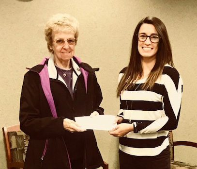 TFCU Member Service representative Deanna Coburn presenting TFCU's donation to Joanne Podres for the Moriah Food Pantry